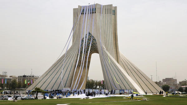 "Iranian hard-liners hang petitions from the Azadi (Freedom) Tower in Tehran during a June 30 demonstration demanding a ""good deal"" in the nuclear negotiations between Iran and six world powers. Negotiators announced a deal Tuesday morning in Vienna."