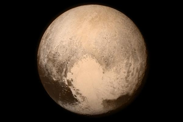"An image of Pluto that was taken by New Horizons shortly before its flyby Tuesday shows a heart-shaped pattern on the planet's surface. NASA says Pluto ""sent a love note back to Earth."""