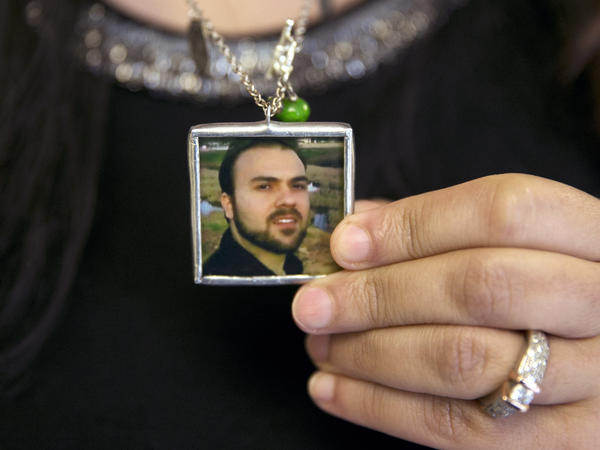Naghmeh Abedini holds a necklace with a photograph of her husband, Saeed Abedini, on June 2.