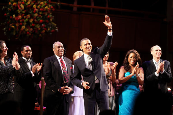 "President Obama joins comedian Bill Cosby and others to sing ""Happy Birthday"" to Sen. Edward M. Kennedy, D-Mass., on March 8, 2009, at The John F. Kennedy Center for the Performing Arts in Washington, D.C."