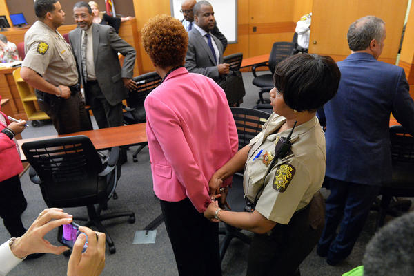 <strong>Georgia: </strong>A Fulton County sheriff's deputy handcuffs former Atlanta Public Schools school research team director Sharon Davis Williams after a jury found her guilty in the Atlanta Public Schools test-cheating trial.