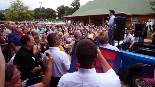 Wisconsin Gov. Scott Walker speaks to an overflow crowd in the Mutt's BBQ parking lot in Mauldin, S.C., after more than 500 showed up for his speech in Upstate South Carolina.