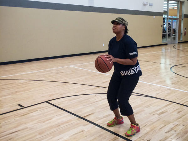 Nikia Smith Robert stopped playing basketball when she was pregnant with her first child, then returned to the game after the baby was born in 2009.