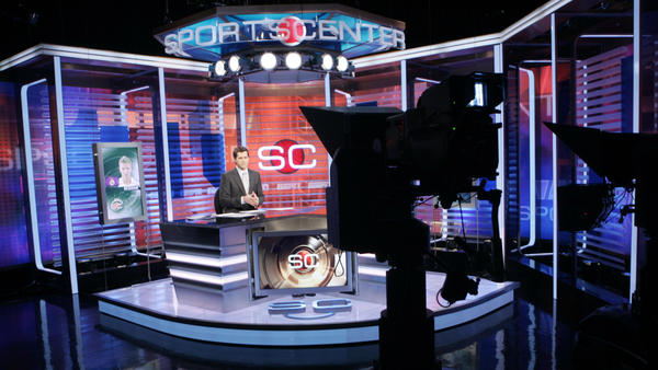 Ryan Phelan rehearses on the set of <em>SportsCenter</em> at ESPN's headquarters in Bristol, Conn., in 2007. Years ago, the network had been thought impervious to the seismic shifts shaking the cable landscape. Now, that appears to be changing.
