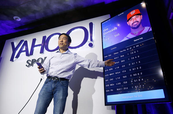 Kelly Hirano, vice president of engineering, demonstrates the Yahoo Sports Daily Fantasy contest during a product launch in July in San Francisco. Yahoo has designed this experience for the mobile fantasy player and offers Daily Fantasy, Full Season Fantasy, and real-time sports news and scores as an all-in-one experience.