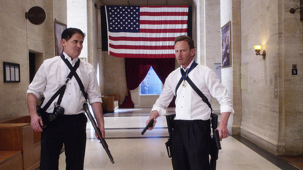 Mark Cuban, left, as President of the United States, faces killer sharks with Ian Ziering in the Syfy film <em>Sharknado 3: Oh Hell No!</em>
