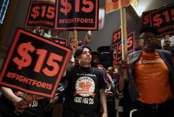 Demonstrators rally before a meeting of a state wage board in New York. On Wednesday, a state panel recommended the minimum wage for fast-food employees be raised to $15 an hour, bypassing the state Legislature.