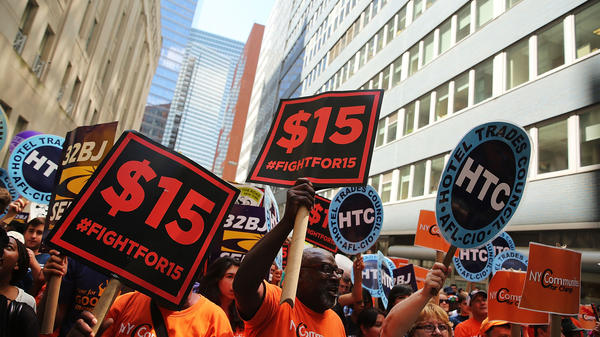 Labor leaders, workers and activists attend a rally for a $15 minimum hourly wage Wednesday in New York City. A panel appointed by Gov.  Andrew Cuomo recommended the increase.