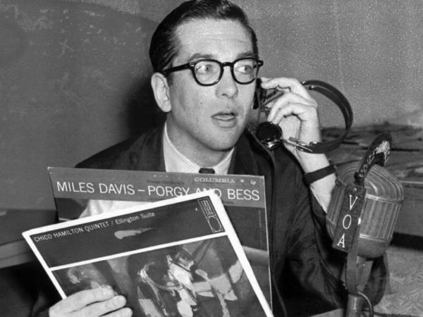 "Willis Conover, an expert on jazz, broadcasts ""Music USA"" from his Voice of America studio in Washington in March 1959."