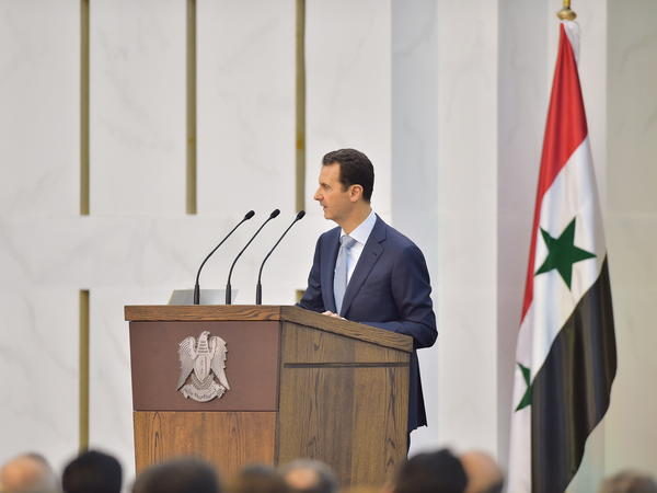 Syrian President Bashar Assad speaks during his meeting with the heads and members of public organizations and professional associations in Damascus, on Sunday. Assad acknowledged that the fight against rebels had suffered setbacks, but vowed to win against insurgents.