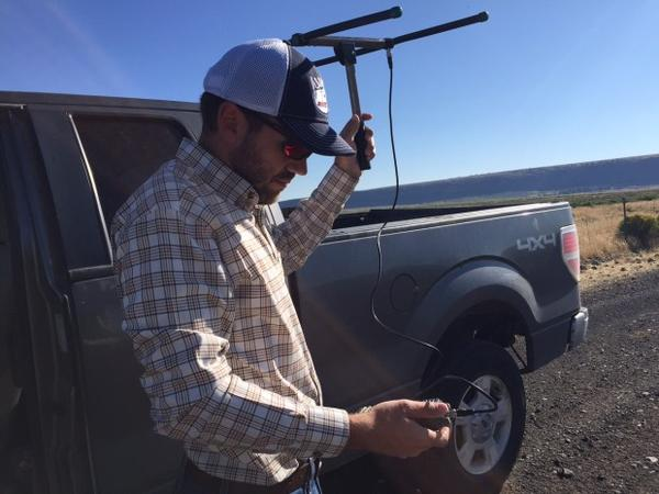 <p>Andrew Shields, a wildlife biologist for Roaring Springs Ranch in southeastern Oregon, searches for a radio collared sage grouse.</p>