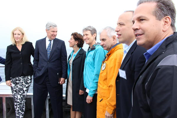 U.S. Bureau of Ocean Energy Management Director Abigail Ross Hopper (far left) and U.S. Secretary of the Interior Sally Jewell (center) celebrated wind farm's construction with Deepwater Wind and state officials.