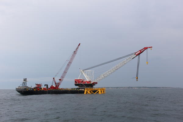 The barge with cranes and the first steel jacket foundation that was installed over the weekend.