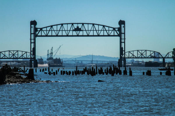 <p>Kayaktavists blocked the Fennica, Shell's icebreaker ship, from leaving the port of Portland Wednesday, July 29, 2015. The railroad bridge was raised, but no boats ever crossed through. The Fennica can be seen in the background to the left of the cranes.</p>