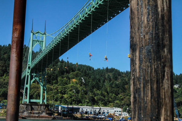<p>Protesters hung from the St. John's Bridge Wednesday in protest of Shell's Arctic drilling efforts.</p>