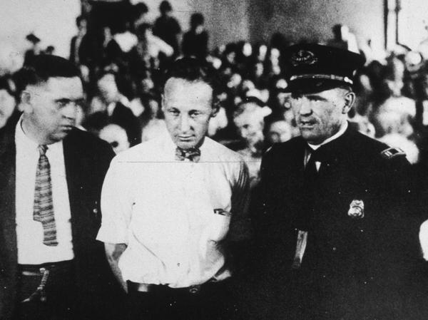 Scopes (center), a high school science teacher, was put on trial for teaching Darwin's theory of evolution, an act that was illegal. He was convicted and fined $100, but the verdict was overturned on appeal.