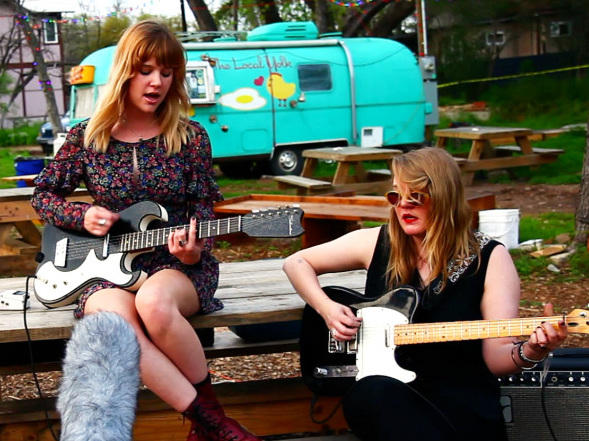 """Bleached performs """"Electric Chair"""" for a Field Recording at the 12th Street Soular Food Garden in Austin, Texas, during SXSW 2012."""