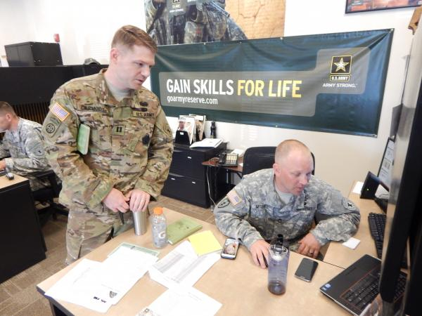 Army Captain Kellam Carmody discusses a recruit's aptitiude test with Army recuriter Kevin Mitchell at the Army Career Center in Tukwila, Washington.