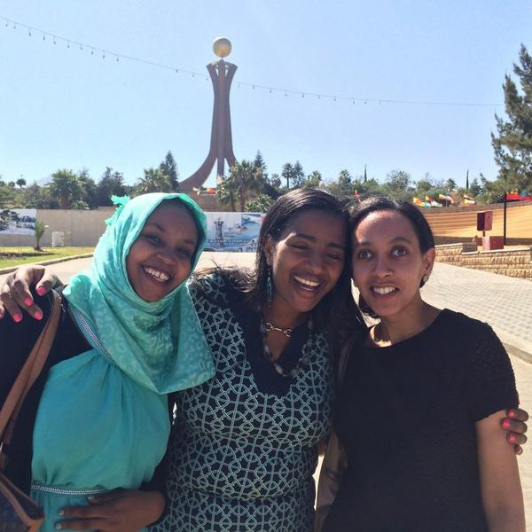 Haben Girma (right) and friends at the Martyrs Memorial in Mekele, Ethiopia, honoring those who died in the country's civil war.