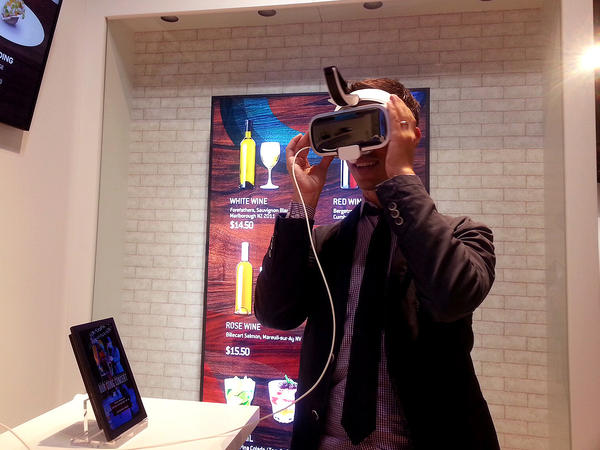NPR reporter Ari Shapiro tries virtual reality goggles at the Samsung Innovation Museum near Seoul.