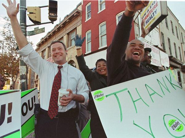 Newly elected Mayor Martin O'Malley (left) waves to supporters in Baltimore in November 1999.