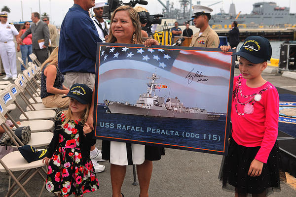 Rosa Peralta, mother of Navy Cross recipient Sgt. Rafael Peralta, holds the photo of the new Navy ship named after her son after a San Diego ceremony Sept. 20, 2013.