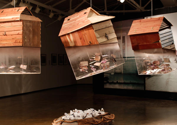 Rontherin Ratliff's <em>Things that Float</em> sculpture contains photographs he rescued from his grandmother's drowned house.