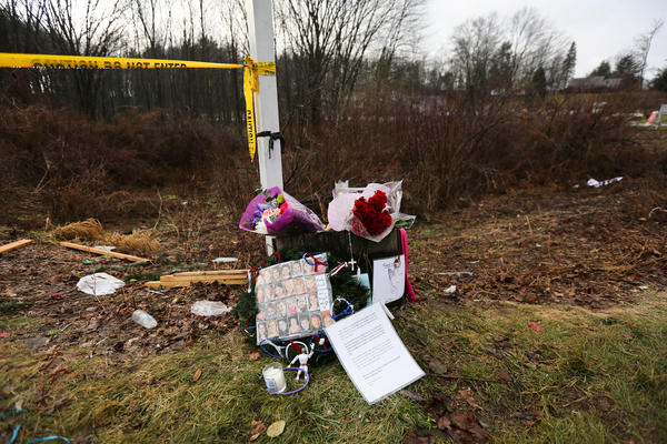 A small memorial lined a road near Sandy Hook Elementary School about a month after the Dec. 14, 2012, shootings in Newtown, Conn.