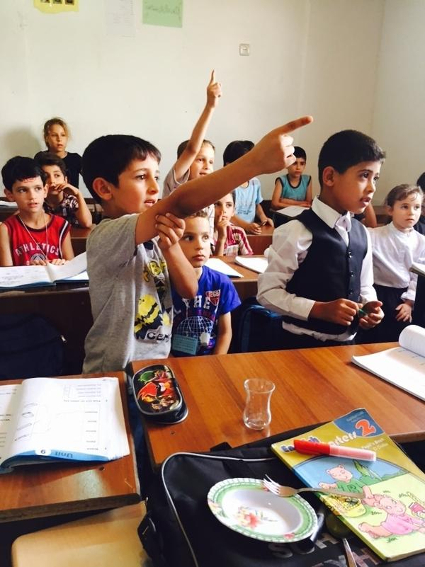 Syrian refugee students in southern Turkey take an English class at the Al Salam school. It opened in 2012 and survives on private donations. A number of others have had to close.