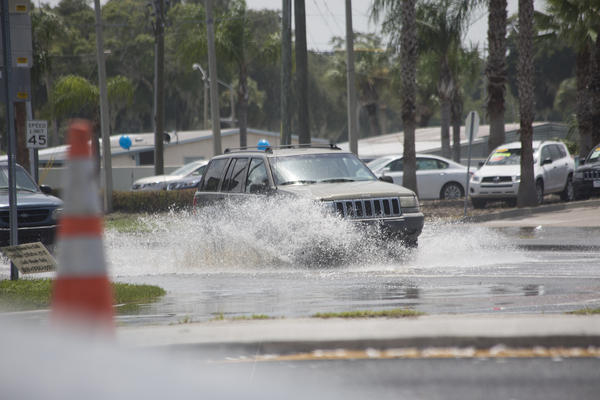 Ridge Road at U.S. 19 was one of several roads closed after flooding stranded motor vehicles. The right lane remained open but cars had to drive slowly through the pooled water.