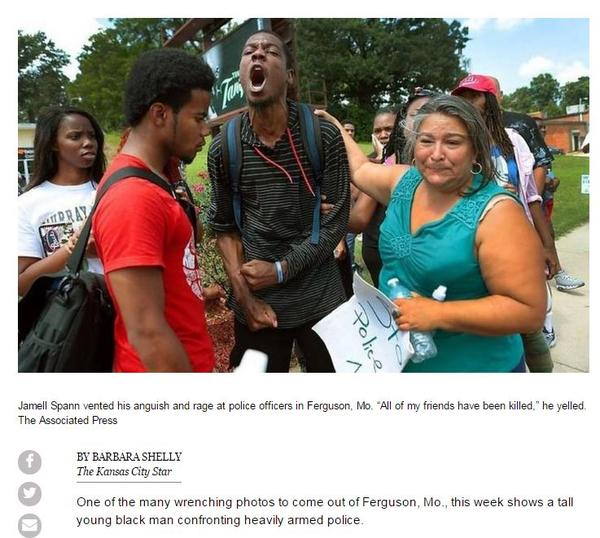 This photograph was published by the Kansas City Star. Jamell Spann, center, at a protest following the Aug. 9, 2014 shooting death of Michael Brown. Elizabeth Vega, right, and several of his friends try to comfort him.