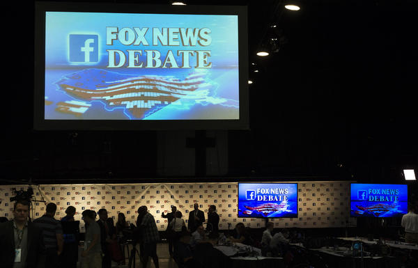Candidate staff and media gather in Cleveland at the scene of Thursday night's Republican primary debate, which is sponsored by Fox News and Facebook.