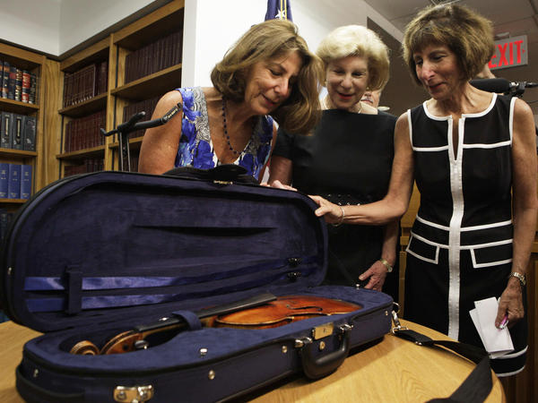"The Totenberg sisters — Amy (from left), Nina and Jill --€"" see their father's stolen Stradivarius for the first time in 35 years at the U.S. attorney's office in New York City on Thursday."