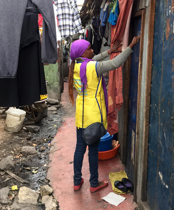 Health workers went door to door to vaccinate residents in Nairobi, Kenya.