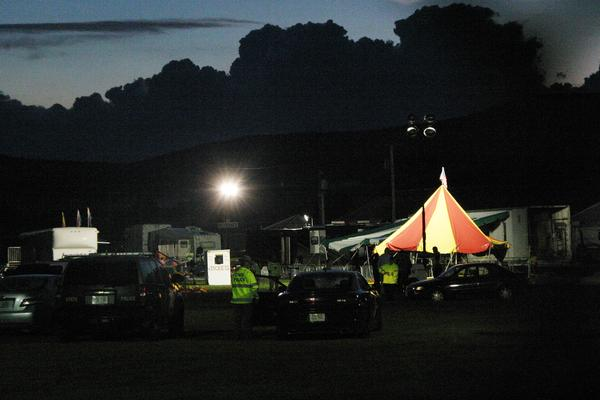 Powerful lights were brought into the fairground as investigators were expected to work through the night. The tent that collapsed is to the left of the red-and-white striped tent.