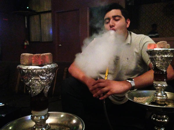 <em></em>Jubin Fallahi enjoys a smoke at the Medina Hookah Lounge in Seattle. There are 11 known hookah lounges in the city, and the mayor wants to shut them all down.