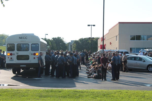 Missouri Department of Corrections bus arrives after protesters are arrested after the I-70 shutdown on August 10