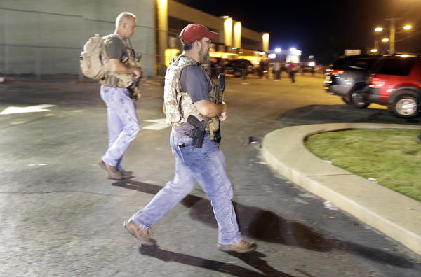 "Heavily armed civilians with a group known as the Oath Keepers in Ferguson, Mo., early Tuesday. St. Louis County Police Chief Jon Belmar has said the presence of the group was ""both unnecessary and inflammatory."""