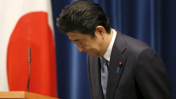 Japanese Prime Minister Shinzo Abe bows after delivering an address marking the 70th anniversary of World War II's end for his country. Abe noted Japan's continued grief over the war, but he also said future generations shouldn't be compelled to apologize for the war.