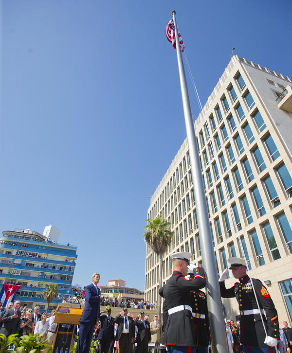 Secretary of State John Kerry (left) and other dignitaries watch the raising of the U.S. flag over the newly reopened embassy in Havana on Friday.