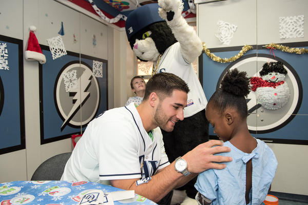 Tampa Bay Rays outfielder Kevin Kiermaier signs an autograph for Janice Clauvil, 6.