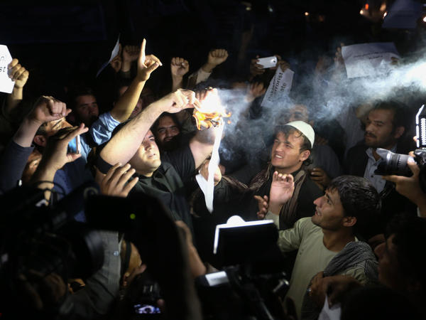 In Kabul, Afghans burned Pakistani currency notes during a vigil for victims of a series of deadly attacks in and around the capital in early August. The Taliban claimed responsibility for some of the attacks.