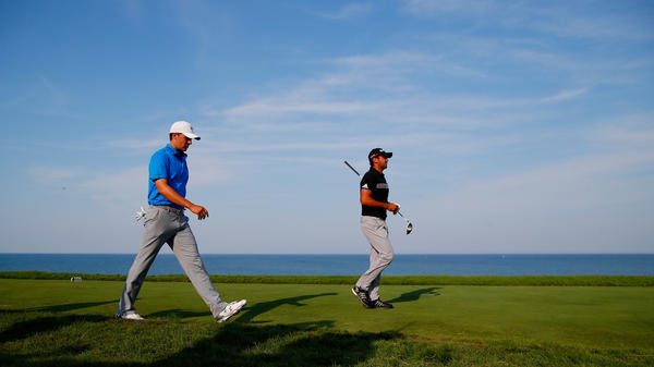 Jason Day (right) walks with Jordan Spieth up the 16th fairway during the PGA Championship at Whistling Straits on Sunday. Day won the championship; Spieth came in second, securing the world No. 1 spot.