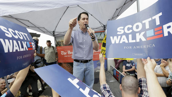 Republican presidential candidate and Wisconsin Gov. Scott Walker speaks at the Iowa State Fair, where he encountered protesters over his record in Wisconsin.