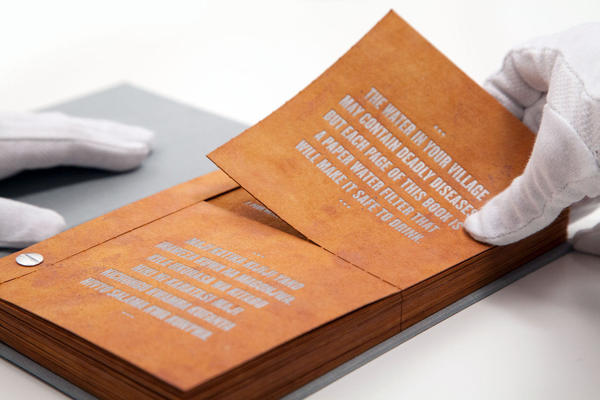 Tear out a page from <em>The Drinkable Book </em>and pour water through it. The built-in filter can wipe out bacteria.