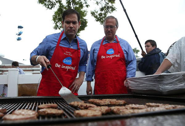Republican presidential candidate and U.S. Sen. Marco Rubio (left) (R-FL) mans the grill with U.S. Rep. David Young (right) (R-IA) at the Iowa Pork Producers Pork Tent during the Iowa State Fair on August 18, 2015 in Des Moines, Iowa. Presidential candidates are addressing attendees at the Iowa State Fair on the Des Moines Register Presidential Soapbox stage and touring the fairgrounds. The State Fair runs through August 23. (Justin Sullivan/Getty Images)