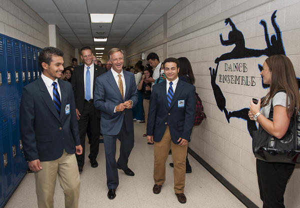 Tennessee Gov. Bill Haslam walks with Antioch High School students last August. He was presenting the Tennessee Promise program to students there.