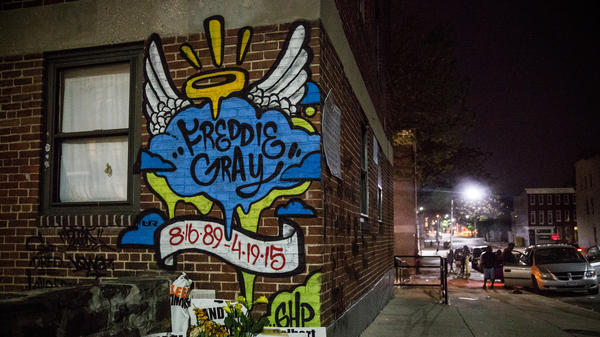 A mural dedicated to Freddie Gray remains in the Sandtown neighborhood of Baltimore where he was arrested in May of this year. Gray's later death in custody sparked days of unrest in the city — and, now, has inspired a course at the University of Maryland law school.