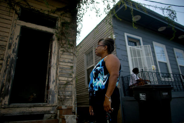 Angela Chalk looks at a home in New Orleans' 7th Ward that hasn't been touched since Hurricane Katrina. Chalk, the vice president of the 7th Ward neighborhood association, spends some of her free time tracking down and reporting dilapidated and abandoned properties.