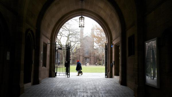 A woman walks through the Old Campus at Yale University. According to a recent op-ed from law professor Victor Fleischer, Yale paid nearly half a billion dollars to private equity managers last year.